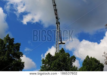 Crane built buildings and houses construction industry structure metal sun