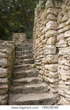 stone stairs in the old castle between two masonry walls