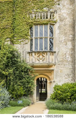 LACOCK, WILTSHIRE, 21ST JUNE 2016 - The Oriel window at Lacock Abbey Wiltshire UK the subject of the first photograph pioneered by William Henry Fox Talbot