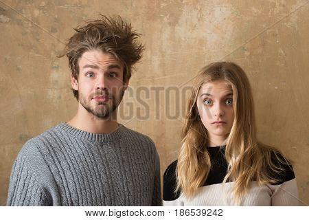 surprised couple of man and woman with surprise or happiness on face have date on beige background