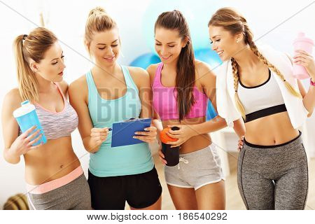 Young women group discussing health plan at the gym