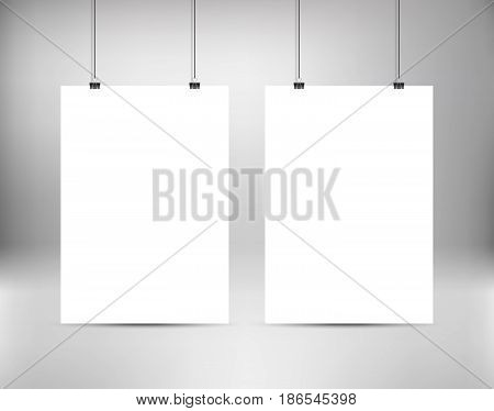 Empty white vector poster templates. Poster mock up. Template of two white blank vector posters. Set of mockups hanging on wall. Frames for paper sheet. Stock vector.