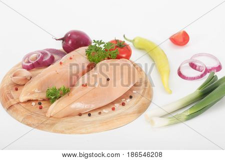 Raw chicken breasts on cutting board. Healthy eating.
