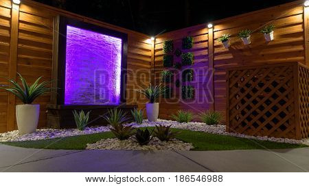 Night Scene Landscape design concept for small spaces with purple water feature
