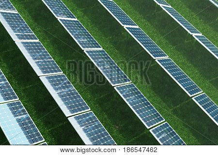 3D illustration Solar energy concept. Solar panels on grass. Blue sky reflection on photovoltaic panel. Power, ecology, technology, electricity