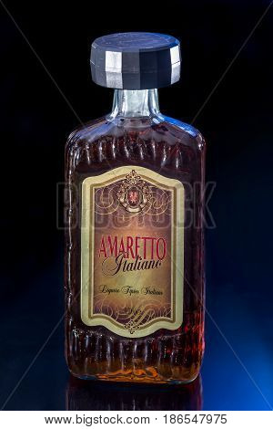 Ternopil, Ukraine - April, 18, 2017: Amaretto Bottle Isolated On Black Background, Made From A Base