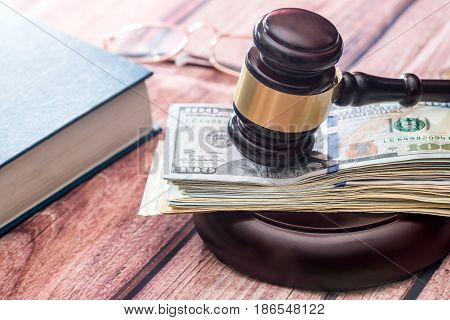 Wooden Gavel With Book And Dollar. Law Concept
