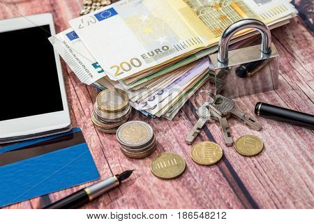 Padlock With Euro Coin And Euro Banknotes, Notepad, Calculator.