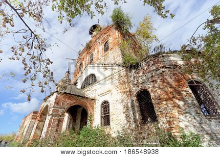 Abandoned Orthodox Church in the European part of Russia. Summer view against a blue sky with clouds.