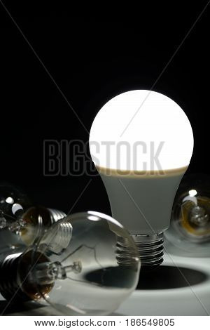 Glowing Led Lamp And Incandescent Bulbs In The Dark