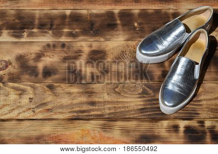 Original Shiny Shoes In Disco Style Lie On A Vintage Wooden Surface Made From Fried Brown Boards. Fa