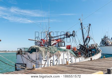 LAAIPLEK SOUTH AFRICA - APRIL 1 2017: A fishing trawler showing nets and equipment at the harbor in the mouth of the Berg River at Laaiplek on the Atlantic coast of South Africa