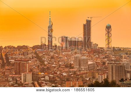 Batumi, Adjara, Georgia - May 27, 2016: Aerial View Of Urban Cityscape At Sunset. Black Sea Technological University, Radisson Blu Hotel, Residential House Porta Batumi Tower And Alphabet Tower
