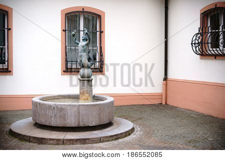MAINZ, GERMANY - APRIL 20: The fish fountain created by Elsa Montag in the Gau Street at the Court of Ostein with a mermaid sculpture on April 20 2017 in Mainz.
