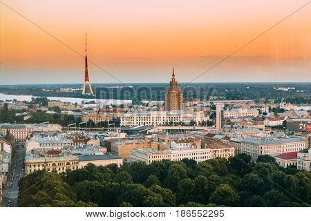 Riga, Latvia - July 2, 2016: Riga Cityscape. Top View Of Riga Television Tv Tower And Building Of Latvian Academy Of Sciences. Aerial View Of Famous Landmarks In Sunset Light Of Summer Evening.