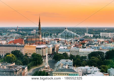 Riga, Latvia - July 2, 2016: Riga Cityscape. Top View Of St. Peter's Church, Boulevard Of Freedom, Freedom Monument And Latvian National Library. Aerial View Of Landmarks In Sunset Of Summer Evening
