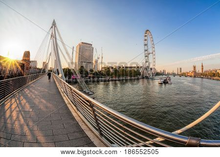 Golden Jubilee Bridge Against Sunrise In London, England, Uk
