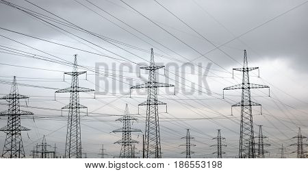 Power line against the background of a cloudy sky.