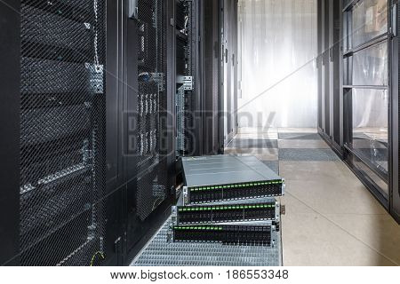 Many hard disks drive in the storage system in the data center on the floor before installation