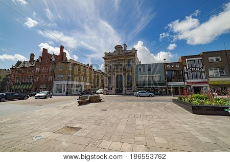 Southampton, UK. 14th May 2017. Bright sunshine on a spring day in central Southampton by the Lower Bar/High Street junction. The buildings vary from old and new. People are walking along the street.