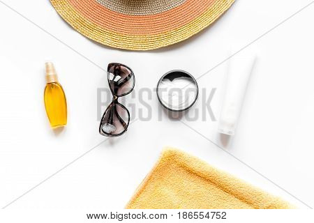 Towel, sun lotion, glasses for summer rest on white background top view