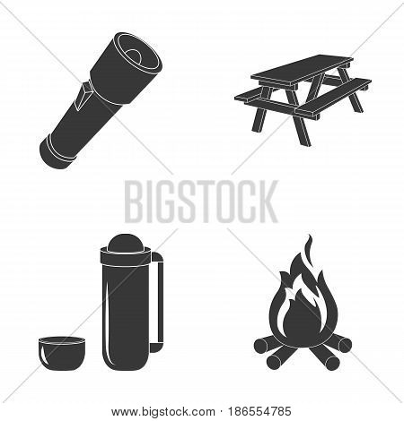 A flashlight, a table with a bench, a thermos with a cup, a caster. Camping set collection icons in black style vector symbol stock illustration .