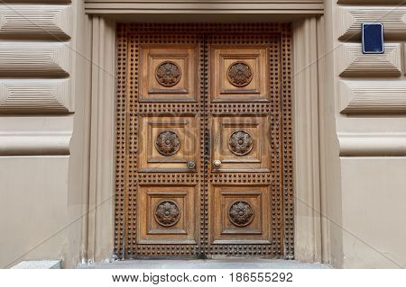 A fancy wooden door of an Art Nouveau building