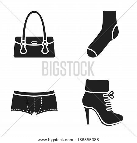 Women's boots, socks, shorts, ladies' bag. Clothing set collection icons in black style vector symbol stock illustration .