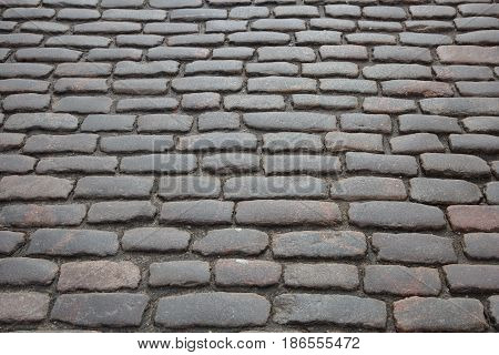 An old, traditional stone brick street road