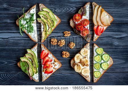 homemade sandwiches composition for breakfast on white table background top view