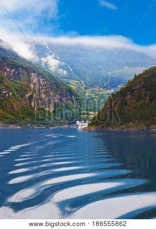 Waves in Geiranger fjord Norway - nature and travel background