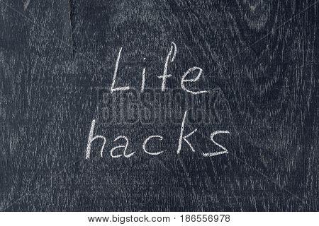 Life Hacks Written On The Blackboard Using Chalk