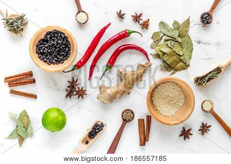 Dry colorful spices, chili pepper for homemade dinner on kitchen stone table background top view