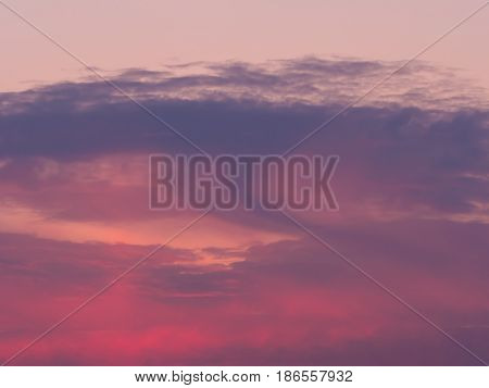 dark magenta clouds at sundown in springtime
