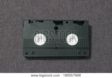 One videocassette on the back side on a gray background