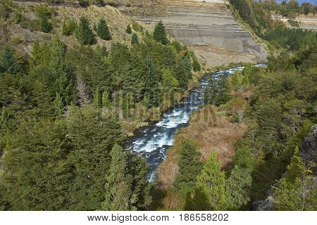 River Truful-Truful running through a deep gorge with colourful eroded cliffs in Conguillio National Park in the Araucania region of Chile