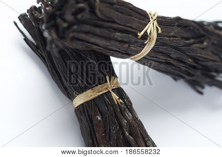 Two fresh bunches of Madagascar vanilla pods against a white background. Food grade and a great promo for articles or recipe ingredients list websites.