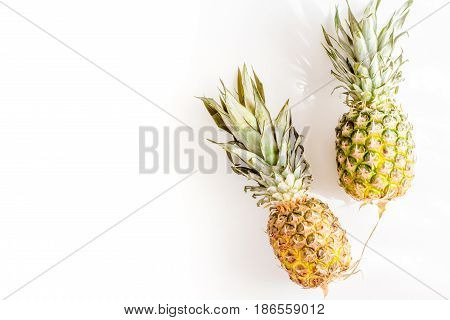 pineapple for exotic fruits summer design on white background top view space for text