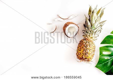 summer mix with pineapple and coconut on white table background top view mockup