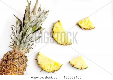 tropical fruits for summer design on white table background top view