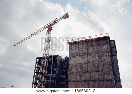 Building a house of panel concrete slabs with a crane. Reinforced concrete. Concept building of new houses from combined materials.