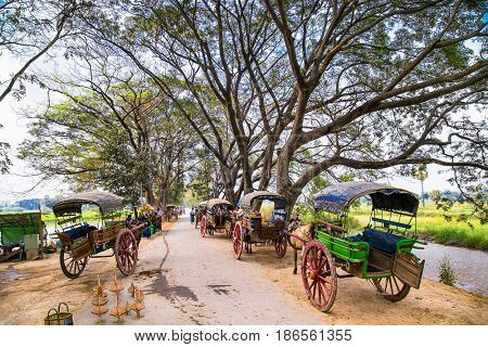 INNWA, MYANMAR-MARCH 6, 2017: Burmaneses tourists tour at horse drawn carriage in Innwa on March 6, 2017, Mandaley. Myanmar. (Burma)