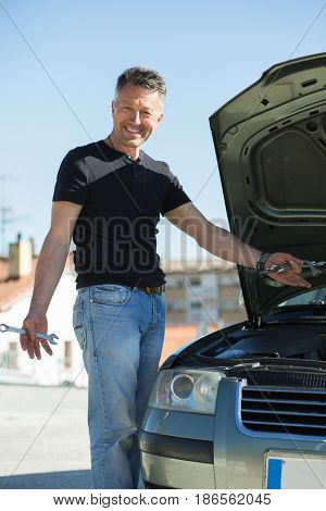 Oil change in car. Man repairing the engine in the car. Self-changing oil in own car.