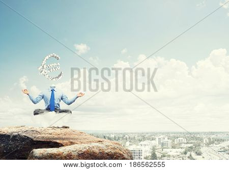 Meditating businessman with euro sign instead of his head