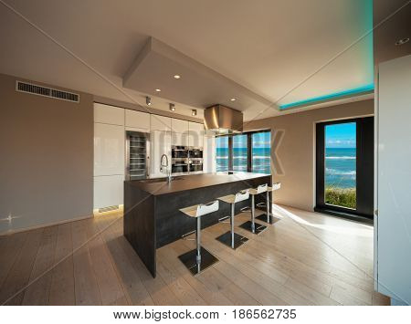 Interiors of a modern apartment, without furniture, sea view