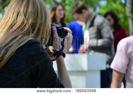 Wedding Photographer In The Process Of His Work. Professional Photographer Shoots A Wedding Ceremony