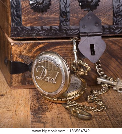 Dad's pocket watch and a wooden chest