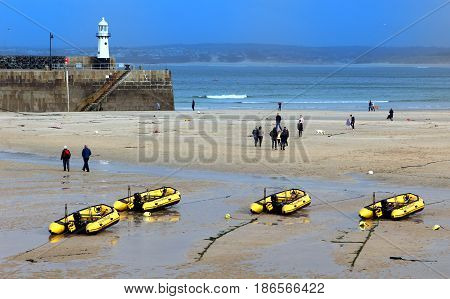 St Ives, Cornwall, Uk - 3Rd April 2017: People Walking Past Inflatable Dinghies Belonging To St Ives
