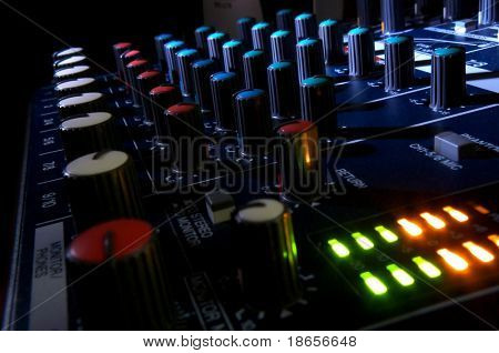 Mixing console at night. Musical background.