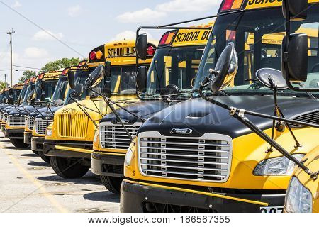 Cincinnati - Circa May 2017: Yellow School Buses in a District Lot Waiting to Depart for Students IV